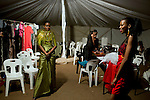 HARARE, ZIMBABWE - SEPTEMBER 25: Models wait backstage before a fashion show on September 25, 2014 at the Harare City library in Harare, Zimbabwe. Local and African and based designers showed their collections during the 5th edition of Zimbabwe Fashion week (Photo by: Per-Anders Pettersson)