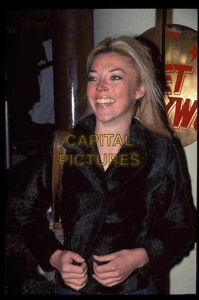 TAMARA BECKWITH.Ref:10813.laughing, furry black jacket, half length, half-length.RAW SCAN - PHOTO WILL BE ADJUSTED FOR PUBLICATION.www.capitalpictures.com.sales@capitalpictures.com.©Capital Pictures.