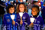 Saoirse O'Connor McCarthy, Millie Hayes and Nathalie Mulumba, Kerins O'Rahillys GAA Club, pictured at the Remembrance of Thomas Ashe, torchlight parade in Ashe Street, on Monday night last.