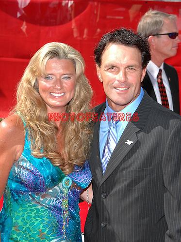 Doug Flutie (right) and Laurie Flutie