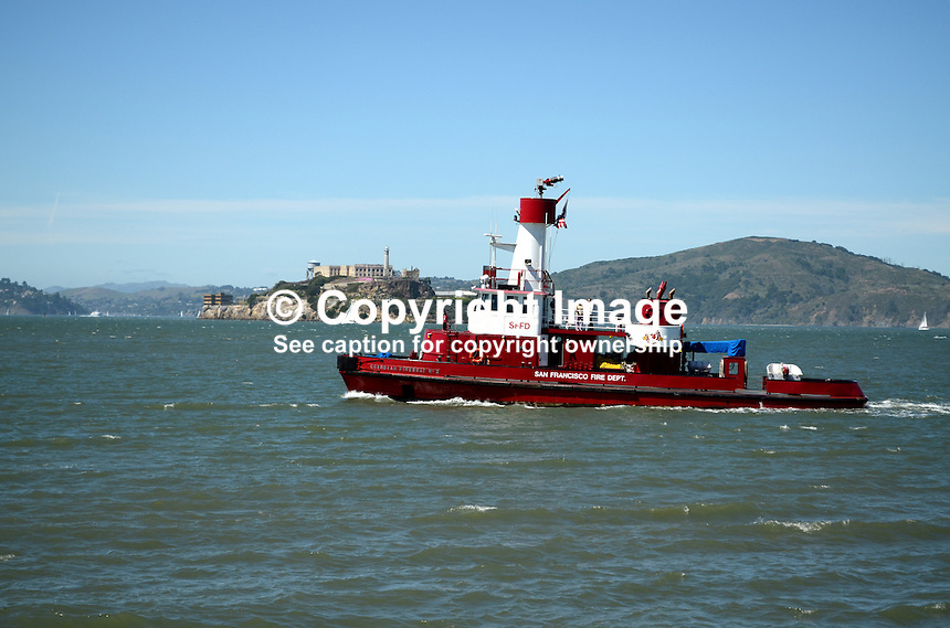Guardian Fire Boat No 2, operated by San Francisco Fire Department, San Francisco, California, USA, on San Francisco Bay with the former prison at Alcatraz in the background. 201304131470<br /> <br /> Copyright Image from Victor Patterson, 54 Dorchester Park, Belfast, UK, BT9 6RJ<br /> <br /> Tel: +44 28 9066 1296<br /> Mob: +44 7802 353836<br /> Voicemail +44 20 8816 7153<br /> Skype: victorpattersonbelfast<br /> Email: victorpatterson@me.com<br /> Email: victorpatterson@ireland.com (back-up)<br /> <br /> IMPORTANT: If you wish to use this image or any other of my images please go to www.victorpatterson.com and click on the Terms &amp; Conditions. Then contact me by email or phone with the reference number(s) of the image(s) concerned.