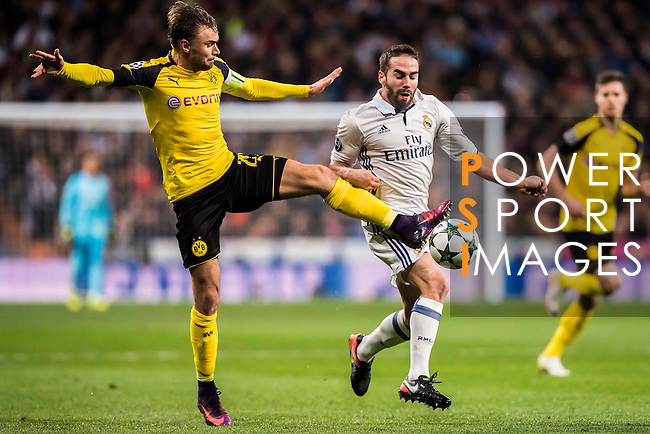 Daniel Carvajal Ramos (r) of Real Madrid battles for the ball with Marcel Schmelzer of Borussia Dortmund during the 2016-17 UEFA Champions League match between Real Madrid and Borussia Dortmund at the Santiago Bernabeu Stadium on 07 December 2016 in Madrid, Spain. Photo by Diego Gonzalez Souto / Power Sport Images