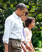 Washington, D.C. - August 1, 2009 -- United States President Barack Obama and his family depart the South Lawn of the White House en route to Camp David on Saturday, August 1, 2009.  From left to right: President Obama; first lady Michelle Obama; and Malia Obama..Credit: Ron Sachs / Pool via CNP