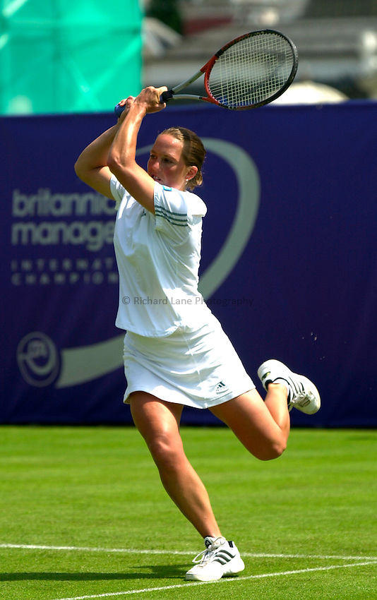 Photo. Rene Solari..19/6/01  .Eastbourne Day 2.  British Lucie Ahl power volleys from her base line but loses to Australian Alicia Molik....