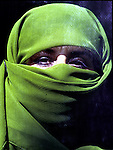 An unidentified covered woman working illegaly for a foreign aid agency on July 27, 1996 in Herat, Afghanistan.  Women are not allowed to study and work by the ruling Taliban regime, who took over most of the country in 1996. .(Photo: Per-Anders Pettersson/Liaison Agency)