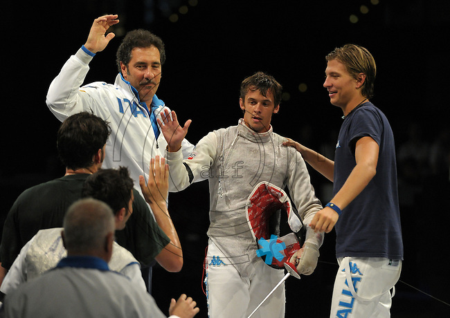 European Championships Fencing 2010 / Fecht Europameisterschaft 2010 in Leipzig - Competition Championat d'europe - im Bild: the new European Champion mens foil team - the Italian Team Andrea Baldini (middle) does the last point Valerio ASPROMONTE (right) and Vitalie Cojocari (Coach) run to him . Foto: Norman Rembarz..Norman Rembarz , Autorennummer 41043728 , Augustenstr. 2, 04317 Leipzig, Tel.: 01794887569, Hypovereinsbank: BLZ: 86020086, KN: 357889472, St.Nr.: 231/261/06432 - Jegliche kommerzielle Nutzung ist honorar- und mehrwertsteuerpflichtig! Persönlichkeitsrechte sind zu wahren. Es wird keine Haftung übernommen bei Verletzung von Rechten Dritter. Autoren-Nennung gem. §13 UrhGes. wird verlangt. Weitergabe an Dritte nur nach  vorheriger Absprache..