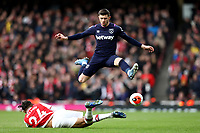 7th March 2020; Emirates Stadium, London, England; English Premier League Football, Arsenal versus West Ham United; Aaron Cresswell of West Ham United avoids the challenge by Reiss Nelson of Arsenal