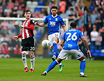 Che Adams of Birmingham City tackles Lee Evans of Sheffield Utd during the championship match at St Andrews Stadium, Birmingham. Picture date 21st April 2018. Picture credit should read: Simon Bellis/Sportimage