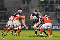 Sale Sharks Bryn Evans tackled by Saracens No 3 Petrous du Plessis during the European Rugby Champions Cup match between Sale Sharks and Saracens at AJ Bell Stadium, Salford, England on 18 December 2016. Photo by Paul Bell.