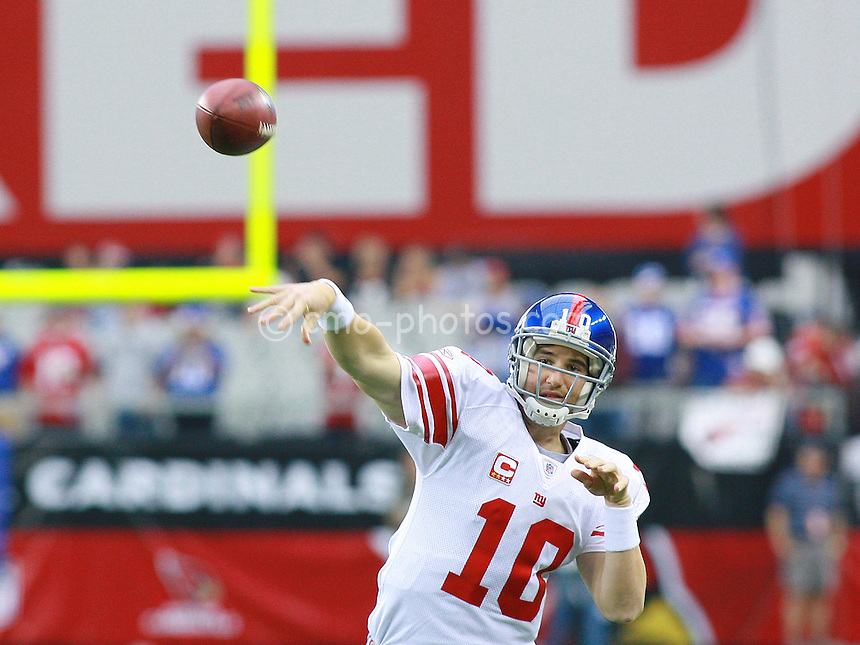 Nov 23, 2008; Glendale, AZ, USA; New York Giants quarterback Eli Manning (10) warms up prior to a game against the Arizona Cardinals at University of Phoenix Stadium.  Mandatory Credit: Chris Morrison-US PRESSWIRE