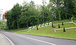 06 June 2006: A road up the hill towards Fritz-Walter Stadium (at left) is the site of a landscaped soccer field sign for the tournament in Kaiserslautern site of several games during the FIFA 2006 World Cup.