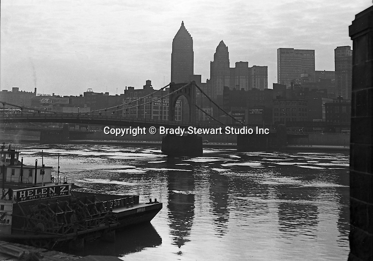 Pittsburgh PA:  View of the city from the Northside of Pittsburgh - 1963.  Early morning photo of the city featuring the Gulf and Koppers buildings