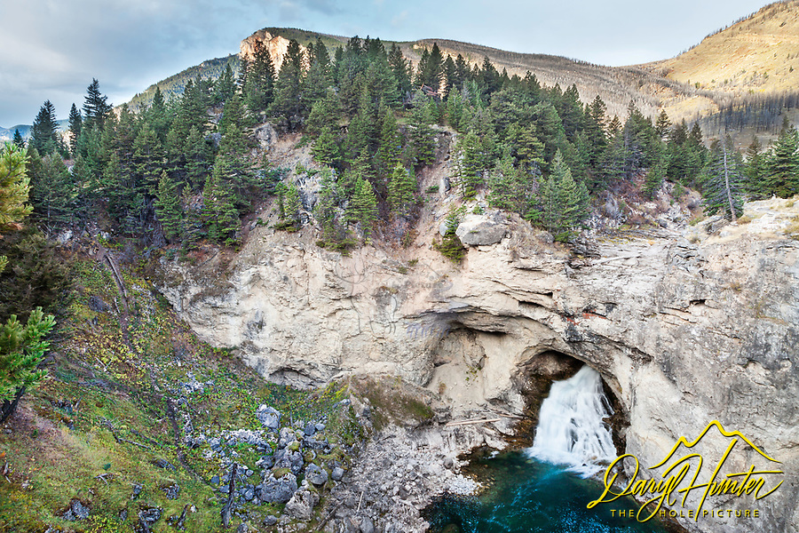 Waterfall at Natural Bridges State Park where the Boulder River flows though the mountain.   At high water it come over the top.  This is near Big Timber Montana.