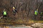 WATERBURY, CT-012318JS11--Workers from Cain's Mechanical of Feeding Hills, Mass., clear brush at the Anamet property in Waterbury on Tuesday. The state has given the city $2.1 million to redevelop the property and clean up has recently begun. <br /> Jim Shannon Republican-American