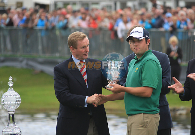 Leading Amateur Paul Cutler (NIR) and An Taoiseach Enda Kenny presenting  him with a Waterford Crystal trophy after the Final Day Sunday round of The Irish Open presented by Discover Ireland at Killarney Golf & Fishing Club on 31st July 2011 (Photo Fran Caffrey/www.golffile.ie)