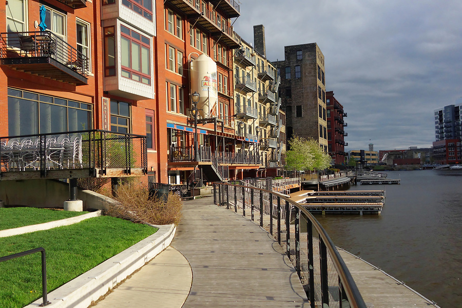 The Milwaukee Riverwalk winds through Historic Third Ward, Milwaukee, Wisconsin, USA