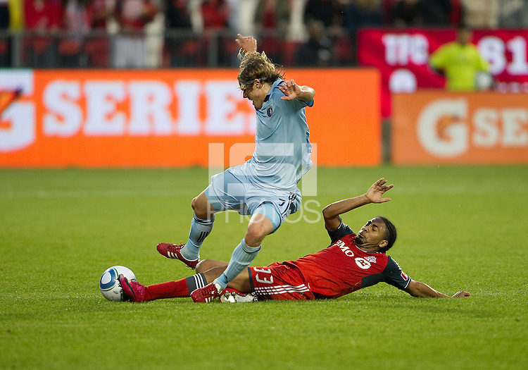 Sporting KC defender/midfielder Chance Myers #7 and Toronto FC forward Javier Martina #33 in action during an MLS game between Sporting Kansas City and the Toronto FC at BMO Field in Toronto on June 4, 2011..The game ended in a 0-0 draw...