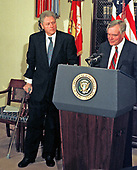 United States President Bill Clinton stands with his crutches as he listens to Governor Lawton Chiles' (Democrat of Florida) remarks on reducing Medicare and Medicaid fraud.<br /> in the Roosevelt room of the White House in Washington, DC on March 25, 1997.<br /> Credit: Ron Sachs / CNP