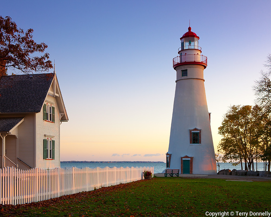 Marblehead Lighthouse State Park, OH<br /> Sunrise light on Marblehead Lighthouse (1819) and Lake Erie, oldest lighthouse in continuous operatoin on the great lakes