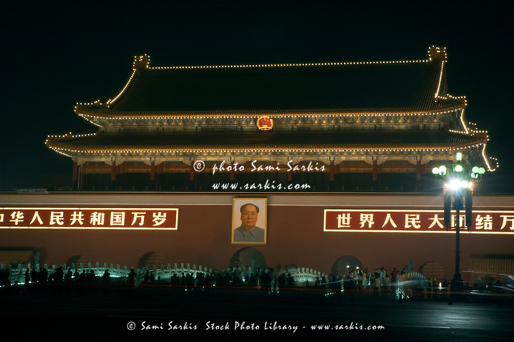 Crowds admiring the decorative lights on the Temple of Heavenly Peace in Tiananmen Square, Beijing, China.