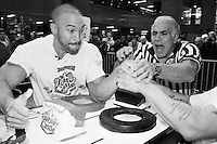 "Referee Bobby Buttafuoco releases his grip to begin an arm wrestling match between Richard Calero, left, and Angel Cosme at the Empire State Finals at the Port Authority Bus Terminal in New York City on November 17, 2005.  The Empire State Finals is the culmination in the year of the New York City Arm Wrestling Association's ""Golden Arm Series""."