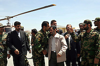 A military commander shakes the hand of President Mahmoud Ahmadinejad and plants a respectful kiss on the Iranian leader's forehead as he prepares to leave the city of Isfahan (Esfahan) by helicopter.