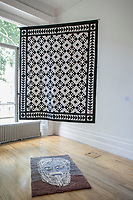 Grindr Quilt; Pardon Rug, Samuel Wingate, 2017. Samuel Wingate has applied his drawings to various objects, creating an installation exploring gay culture in 2017. This includes a doubled-sided quilt that replicates the black-and-white tiled floor of the Stevens Building, with drawings of men found on Grindr within the Kensington area on the reverse.