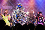 """June 24, 2013, Tokyo, Japan -  Japanese pop-duo Amoyamo perform on stage with Robot band Z-Machines during a special live performance at Liquidroom in downtown Tokyo. The guitarist """"Mach"""" can slide, shred and mute as he is also equipped with a body and soul system that allows him to head-bang. The drummer """"Ashura"""" consists of 4 snare drums, 2 crash cymbals and 3 bass drums while the keyboardist """"Cosmo"""" is equipped with a unique eye beam function. (Photo by Christopher Jue/Nippon News)"""