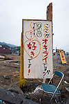 "A sign stands on the grounds of an ad hoc playground built in the center of the Okirai district of Sanriku Town, Ofunato City, Iwate Prefecture, Japan on  12 June 2011.  The sign plays on the name of the district Okirai, a homonym for which means ""dislike."" ""Is this  Okirai?/Do you dislike this place? Yes, but, but, I love it!"" it reads.The playground was built by recycling debris from the March 11 tsunami with participation by the local children..Photographer: Robert Gilhooly"