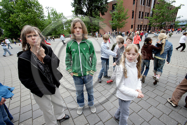 BRUSSELS - BELGIUM - 08 MAY 2007 -- Teacher Rikke SAUZET with one of her students student Troels KARLSEN in green shirt at the Danish section of The European School in Uccle, Schola Europaea Bruxellensis I.  Photo: Erik Luntang/EUP-IMAGES