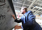 SIOUX FALLS, SD - OCTOBER 16:  Sioux Falls Mayor Mike Huether signs his name on the last beam to be placed in the Denny Sanford Event Center that will enclose the building.  (Photo by Dave Eggen/Inertia)