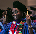 Students flip their tassels after receiving their degrees during the DePaul University College of Law commencement ceremony, Sunday, May 13, 2018, at the McCormick Place Grand Ballroom in Chicago, IL. Approximately 280 students received their Juris Doctors or Master of Laws degrees during the event. (DePaul University/Jamie Moncrief)