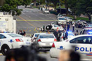 October 3, 2013  (Washington, DC)  Police secure the scene where a US Capitol Police car crashed into a barricade as it pursued a vehicle. A woman was killed by police a short distance away.  (Photo by Don Baxter/Media Images International)