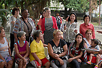 Harriett Olson (in red sweater), the chief executive officer of United Methodist Women, visits with people in the Manila North Cemetery in Manila, Philippines, on January 16, 2018.  She was accompanied by other UMW leaders and officials from the UMW-supported Kapatiran-Kaunlaran Foundation (KKFI), which carries out educational and other work in the cemetery. <br /> <br /> Olson was in the Philippines to meet with women from throughout the region.