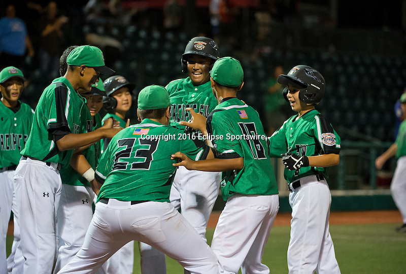 ABERDEEN, MD - AUGUST 01: Jameson Hussey #24 of Honolulu (HI)  is congratulated after hitting a two run home run during a game between Pacific Southwest and Maryland during the Cal Ripken World Series at The Ripken Experience Powered by Under Armour on August 1, 2016 in Aberdeen, Maryland. (Photo by Ripken Baseball/Eclipse Sportswire/Getty Images)