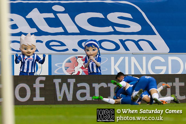 Wigan Athletic 1 Shrewsbury Town 0, 21/11/2015. DW Stadium, League One. The DW Stadium. Wigan Athletic earned a narrow 1-0 at home to Shrewsbury Town. Wigan competed in the Premier League from 2005 to 2013. They won the 2013 FA Cup. The club also embarked on its first European campaign during the 2013–14 UEFA Europa League. Mascots Pheonix and Blue, watch as Wigan players celebrate the goal scored by Wigan Athletic's Alex Revell.   Photo by Paul Thompson