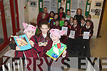PRIMARY SCIENCE: Mercy Moyderwell students were highly commended for their project at the Primary Science Fair at the Young Scientist Exhibition in the RDS last week. Front l-r: Gearoid Lee, Niamh O'Connor and Grainne Clerkin. Back l-r were: Kevan Foley, Ciara McCarthy, Dejana Grubnejsic, Maeve O'Donoghue, Jack Duggan, Thomas Houston, Beatrice Mekauskaite, Michale Edgar, Sean O'Mahony, Nina Duggan, Jonathon O'Shea and Emma Leahy, teachers Mr. Mullins, Ms. Jones and Principal Maire Quinlan..
