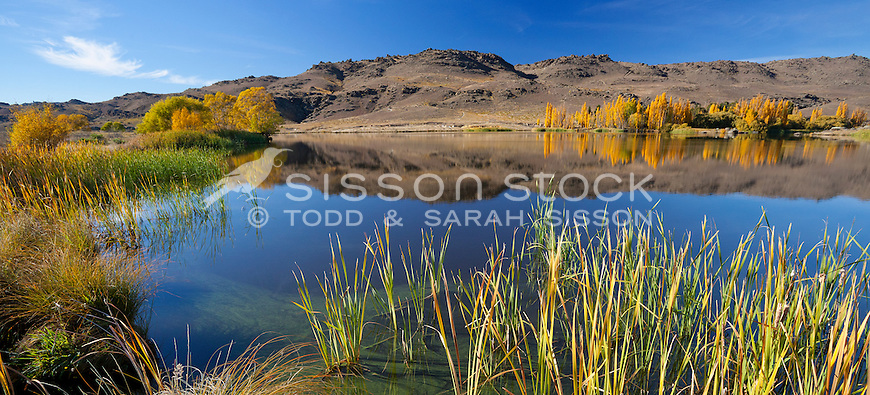 Autumn reflections at Butchers dam near Alexandra, Central Otago, New Zealand - stock photo, canvas, fine art print