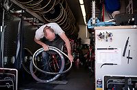 mechanic Jean-Pierre Christiaens at work in the teamtruck, puting on some fresh rubber<br /> <br /> Stage 21 (ITT): Verona to Verona (17km)<br /> 102nd Giro d'Italia 2019<br /> <br /> ©kramon