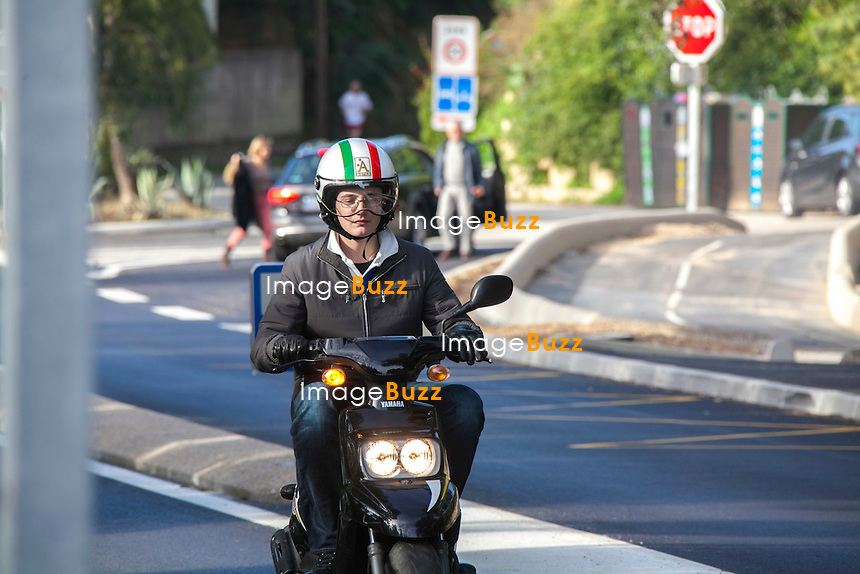 NICOLAS SARKOZY AND HIS SON LOUIS SARKOZY - December 29, 2012. Nicolas Sarkozy is enjoying his bicycle as his son Louis is doing some scooter, while the family is spending some vacation together in Cap Nègre. France, December 29, 2012.