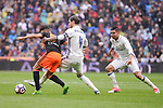 Real Madrid's Sergio Ramos and Carlos Henrique Casemiro and Valencia CF's Munir El Haddadi during La Liga match between Real Madrid and Valencia CF at Santiago Bernabeu Stadium in Madrid, April 29, 2017. Spain.<br /> (ALTERPHOTOS/BorjaB.Hojas)
