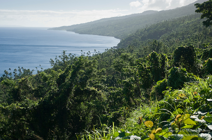 Taveuni, Fiji; an elevated view of the coastline and lush vegetation along the west side of the island, overlooking the Somosomo Strait