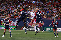 New York Red Bulls forward John Wolyniec (15) battles for a header with New England Revolution midfielder Shalrie Joseph (21) and defender Jay Heaps (6). The New York Red Bulls and the New England Revolution played to a 1-1 tie during a Major League Soccer match at Giants Stadium in East Rutherford, NJ, on April 19, 2008.