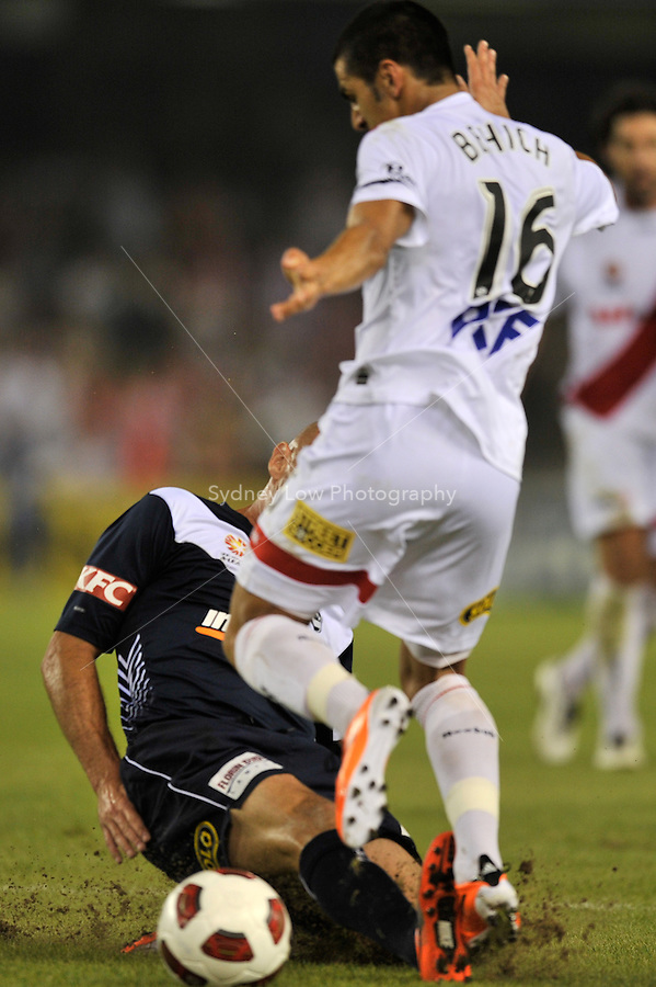 MELBOURNE, AUSTRALIA - JANUARY 22: Kevin Muscat of the Victory tackles Aziz Behich of the Heart in round 24 of the  A-League match between the Melbourne Victory and the Melbourne Heart at Etihad Stadium on January 22, 2011 in Melbourne, Australia. (Photo Sydney Low / AsteriskImages.com)
