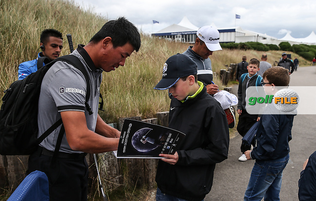 Autograph signing for Wu Ashan (CHN) during Round Two of the 2016 Aberdeen Asset Management Scottish Open, played at Castle Stuart Golf Club, Inverness, Scotland. 08/07/2016. Picture: David Lloyd | Golffile.<br /> <br /> All photos usage must carry mandatory copyright credit (&copy; Golffile | David Lloyd)