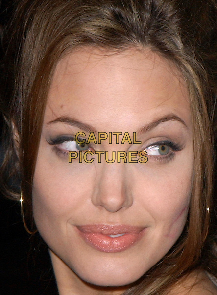 ANGELINA JOLIE.World Premiere of Taking Lives held at The Grauman's Chinese Theatre in Hollywood, California .16 March 2004.*UK Sales Only*.headshot, portrait, look closer, lipstick mark on cheek.www.capitalpictures.com.sales@capitalpictures.com.©Capital Pictures.