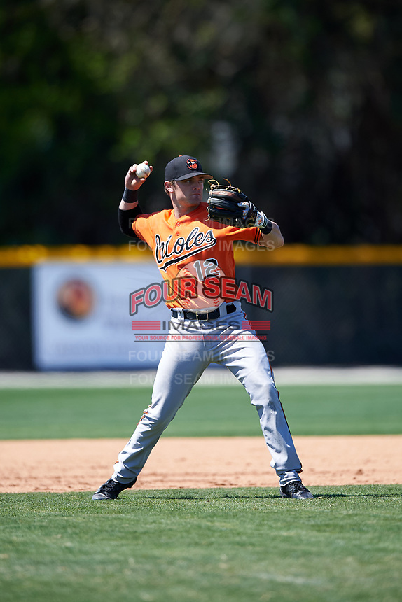 Baltimore Orioles Tanner Kirk (12) throws to first base during a minor league Spring Training game against the Minnesota Twins on March 17, 2017 at the Buck O'Neil Baseball Complex in Sarasota, Florida.  (Mike Janes/Four Seam Images)