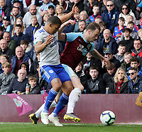 Burnley's Ashley Barnes is fouled by Cardiff City's Lee Peltier<br /> <br /> Photographer Rich Linley/CameraSport<br /> <br /> The Premier League - Saturday 13th April 2019 - Burnley v Cardiff City - Turf Moor - Burnley<br /> <br /> World Copyright © 2019 CameraSport. All rights reserved. 43 Linden Ave. Countesthorpe. Leicester. England. LE8 5PG - Tel: +44 (0) 116 277 4147 - admin@camerasport.com - www.camerasport.com