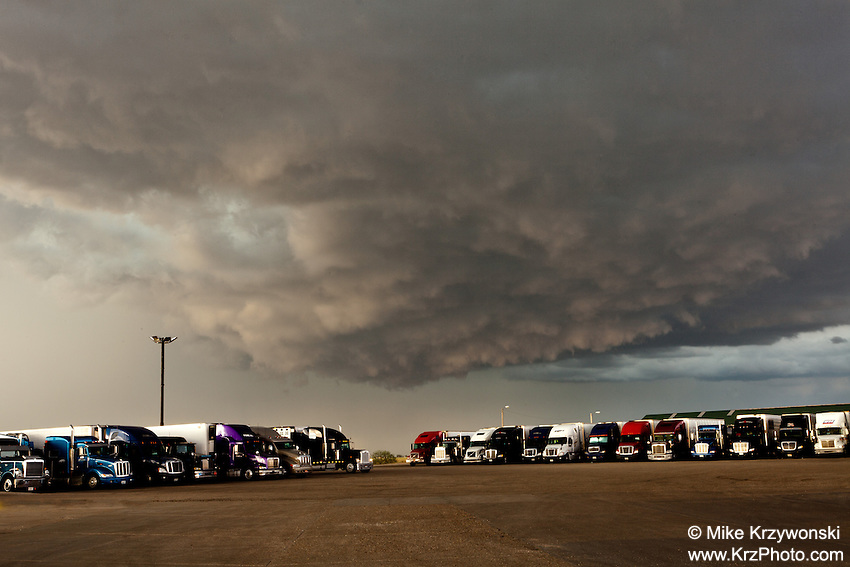 Dark storm clouds above semi trucks at a truck stop in Wyoming, June 7, 2012