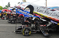 Aug. 5, 2011; Kent, WA, USA; The NHRA funny cars of Tim Wilkerson (right), Bob Tasca III (center) and Jeff Diehl sit lined up in the staging lanes during qualifying for the Northwest Nationals at Pacific Raceways. Mandatory Credit: Mark J. Rebilas-